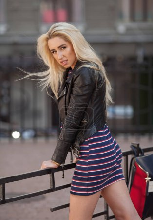 Photo for Fashion stylish beautiful young blonde woman model in summer casual clothes posing on street background - Royalty Free Image