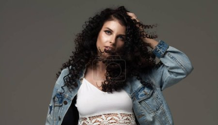 Photo for Beautiful brunette woman with beauty long curly hair. Fashion model with wavy hairstyle - Royalty Free Image