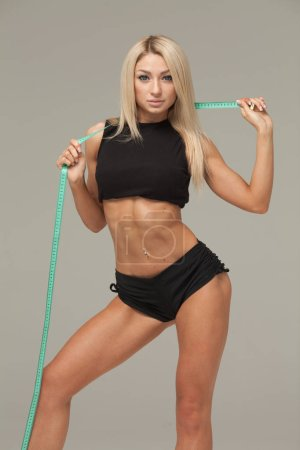 Photo for Successful weight loss, beautiful female waist, diet concept - Royalty Free Image