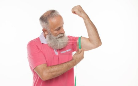 Photo for Strong old man measuring his arm, isolated on white - Royalty Free Image