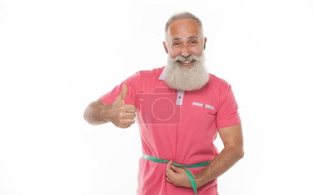 Photo for Senior man measuring waist with a tape. Lose weight concept. - Royalty Free Image