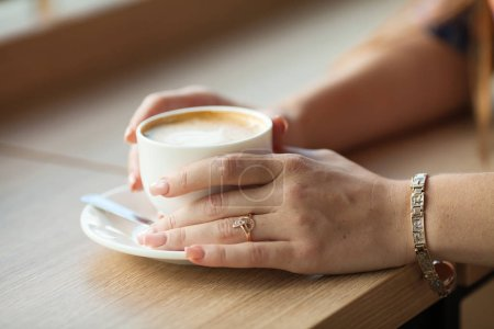 Photo for Cup of latte coffee on wooden table - Royalty Free Image