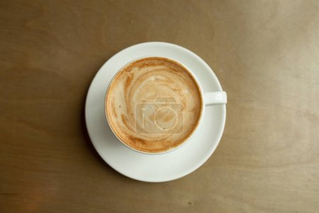 Photo for Close-up of coffee latte and cappuccino as flat lay from above - Royalty Free Image