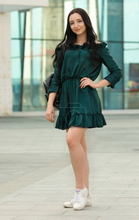 Photo for Beautiful young brunette woman walking in city - Royalty Free Image