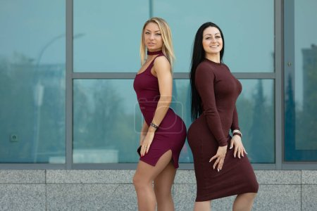 Photo for Two pretty young women posing together outdoors - Royalty Free Image