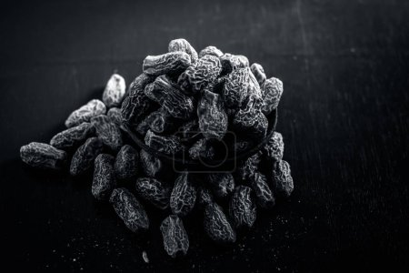 Photo for Close up of dried dates on wooden table - Royalty Free Image