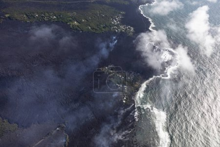 Aerial view of lava flows from the eruption of Kilauea volcano in Hawaii flowing into the sea near Kapoho, May 2018