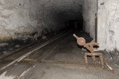 Railway tracks with a crossover in a tunnel of an abandoned lime mine in Switzerland
