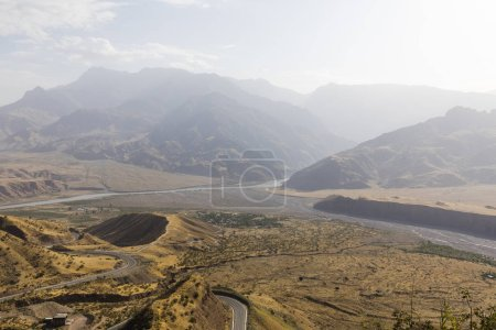Photo for Landscape at Kamar in Tajikistan. The valley in the center of the picture is the starting point for the legendary Pamir Highway - Royalty Free Image