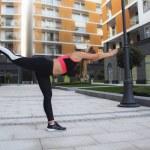 Girl Practicing Yoga Outdoors...