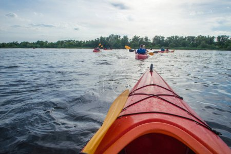 People in kayaks on the river