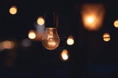 Photo for Decorative Lamps luminosity, dark evening background - Royalty Free Image
