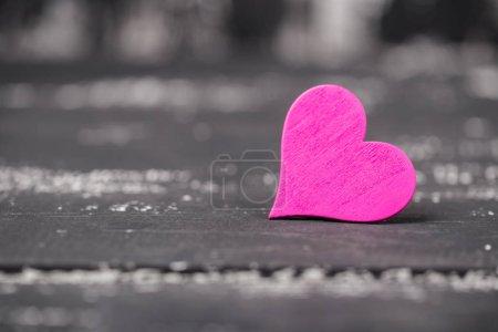 Wooden heart on dark grunge wooden background, valentine day concept
