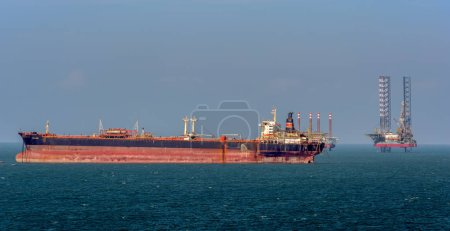 """VUNG TAU, VIETNAM - Mar 30, 2017: Vietnamese supertanker """"Chi Linh"""" (former 'Krym') anchored next to floating offshore oil rig South China Sea and now using as crude oil floating storage."""