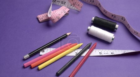 Photo for Sewing accessories on a pink background - Royalty Free Image