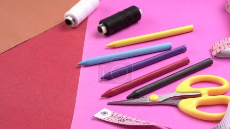 Photo for Sewing tools and accessories for needlework on pink background - Royalty Free Image