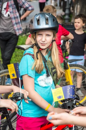 "Photo for Odesa city, Ukraine, May 19, 2019. The event ""bicycle day"". Bicyclists, adults and children, their portraits. Riding people on sports bikes. Congratulations to the winners on stage. Streets and park. Outdoors. - Royalty Free Image"