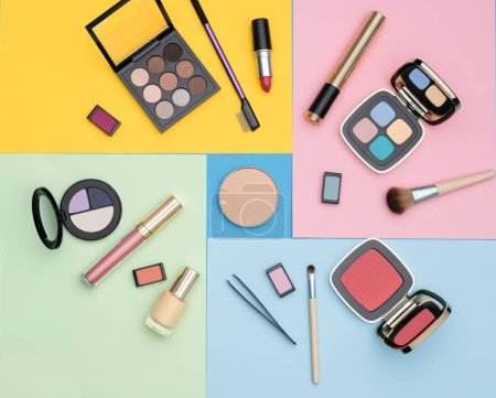 Photo for From above various decorative cosmetics placed on colorful bright background as illustration for fashion and makeup article - Royalty Free Image