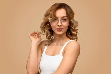 Confident woman touching hair
