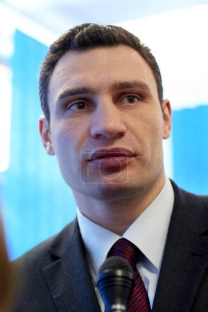 KIEV, UKRAINE - May 21, 2006: Ukrainian politician, boxer Vitali Klitschko in his office. He gives an interview before the election in fighting for the post of mayor of Kiev