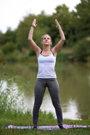 Yoga exercises outdoors / A young girl / Portrait...