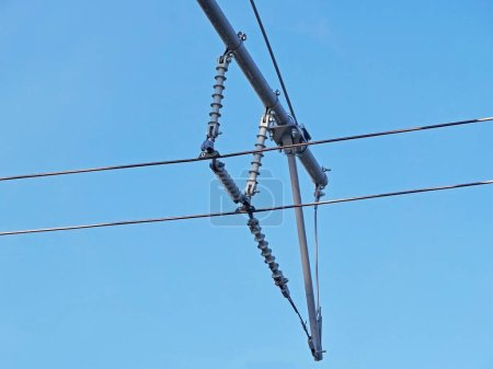 Photo for Contact wires of a trolley bus against a blue sky - Royalty Free Image