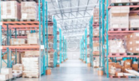blurred warehouse inventory product stock with container stack for logistic business background, warehouse interior background