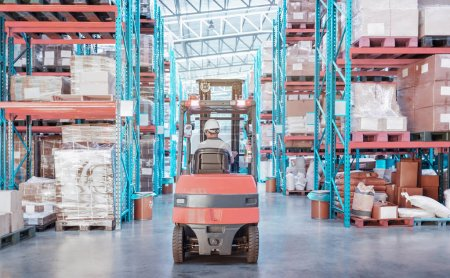 Photo for Warehouse metal structure interior with  forklift truck in selective focus, rows of merchandise shelves with goods container boxes - Royalty Free Image
