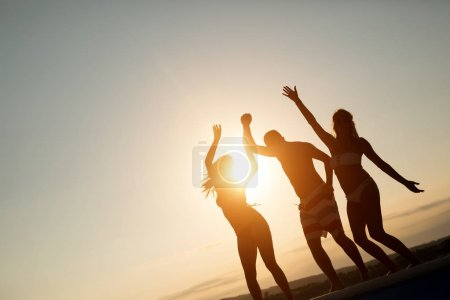 Photo for Friends partying at sunset during summer vacation - Royalty Free Image