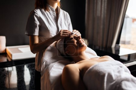 Beautiful young woman enjoying massage and rejuvenating
