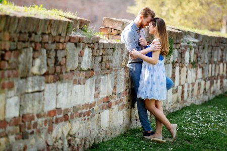 Beautiful ccute young couple hugging in nature