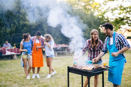 Photo for Young people having  bbq party in nature - Royalty Free Image