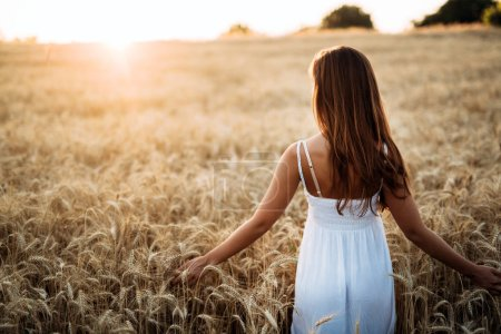 Photo for Young beautiful happy woman spending time in nature - Royalty Free Image