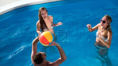 Photo for Group of happy people partying in pool - Royalty Free Image