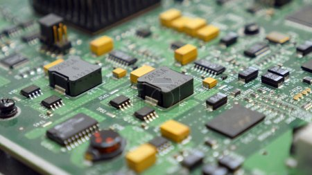 Photo for Detail of an electronic printed circuit board with many electrical components - Royalty Free Image