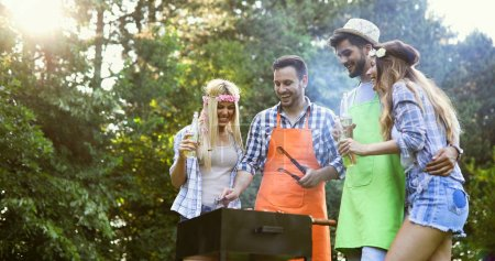 Photo for Happy people having camping and having bbq party outdoor - Royalty Free Image