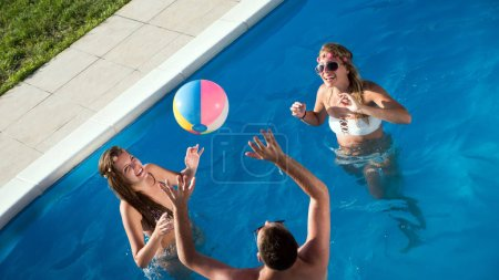 Photo for Group of happy young people enjoying summer at pool - Royalty Free Image