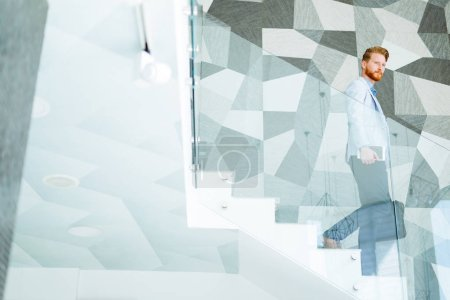 Businessman taking the stairs living a dynamic life