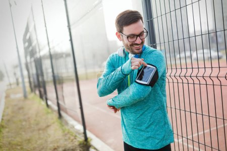 Active sportsman fitness exercising while running and jogging outdoor
