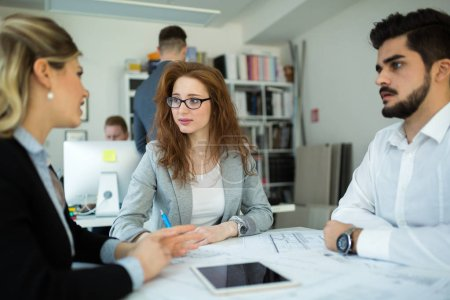 Photo for Professionals business colleagues collaborating and discussing project plans - Royalty Free Image