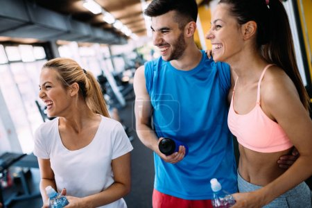 Photo for Fitness, sport, exercising and healthy lifestyle concept - group of happy people in gym - Royalty Free Image