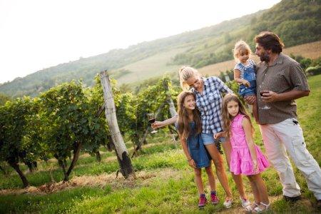 Winemaker family together in vineyard