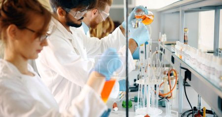 Photo for Young students of chemistry working together in laboratory - Royalty Free Image