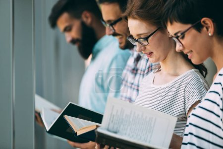 Photo for Group of college students studying at the library - Royalty Free Image