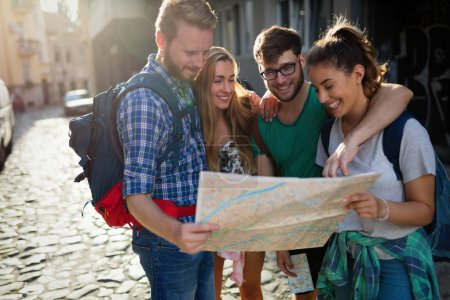 Photo for Happy group of tourists traveling and sightseeing together - Royalty Free Image