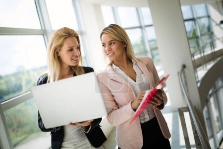 Photo for Picture of professional female saleswomen working in car dealership - Royalty Free Image