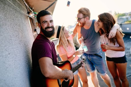 Photo for Group of friends enjoying party. Friends having fun at rooftop party. - Royalty Free Image