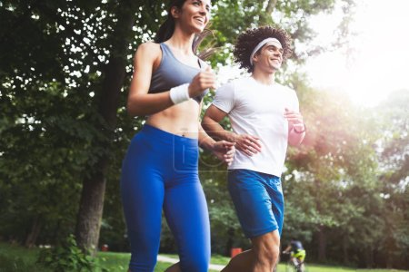 Photo for Beautiful couple jogging running in nature living healthy - Royalty Free Image