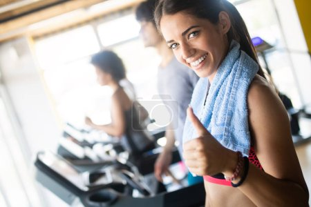 Photo for Picture of cheerful young fitness team in gym - Royalty Free Image