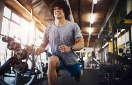 Photo for Sport, fitness, bodybuilding, lifestyle and people concept - man exercising work out in gym - Royalty Free Image